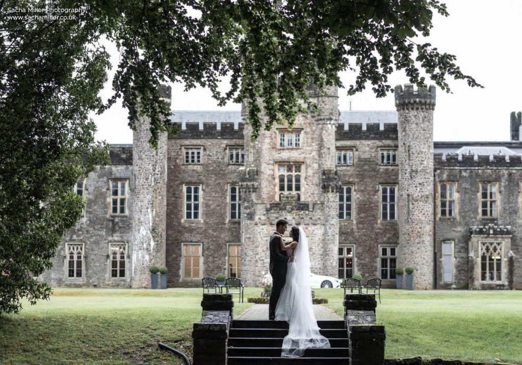Bride and groom outside Hensol Castle - photo credit Sacha Miller photography